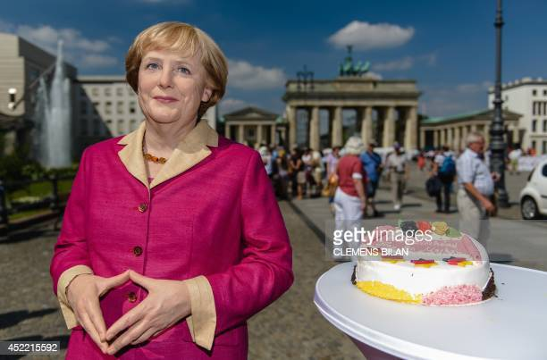 A wax likeness of German Chancellor Angela Merkel is pictured in front of the Brandenburg Gate in Berlin on July 16 on the occassion of Merkel's 60th...