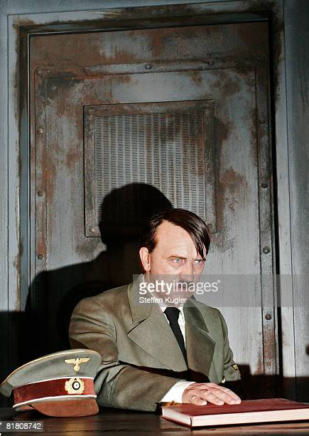 A wax model of Adolf Hitler during the final days in the FuehrerBunker is displayed at the Berlin Branch of Madame Tussauds on July 3 in Berlin...