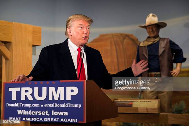 STATES JANUARY 18 A wax statue of John Wayne watches as Republican presidential candidate Donald Trump speaks during a news conference at the John...
