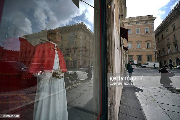 A wax statue of Pope John Paul I is displayed in the window of the Rome wax museum on March 11 2013 in Rome Catholic cardinals had a final day of...