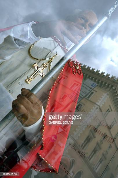 A wax statue of Pope John Paul II is displayed in the window of the Rome wax museum on March 11 2013 in Rome Catholic cardinals had a final day of...