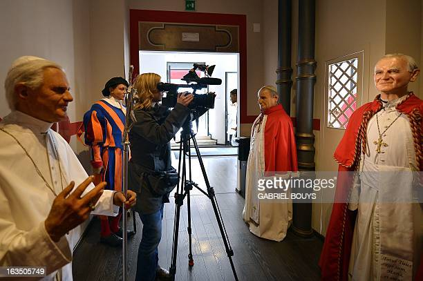 Wax statues of Pope John Paul II and Pope Benedict XVI are displayed at the Rome wax museum on March 11 2013 in Rome Catholic cardinals had a final...