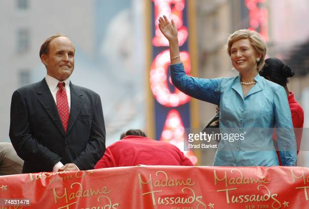 Wax statues of US Sen Hillary Clinton and former New York City mayor Rudy Giuliani are seen on the Madame Tussauds Wax Shuttle in the Times Square...