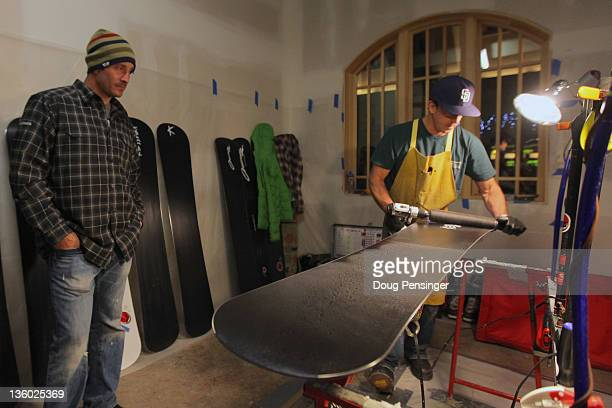 Wax technician Curtis Bacca prepares snowboards for Seth Wescott in the waxroom on the eve of the LG Snowboard-Cross FIS World Cup on December 16,...