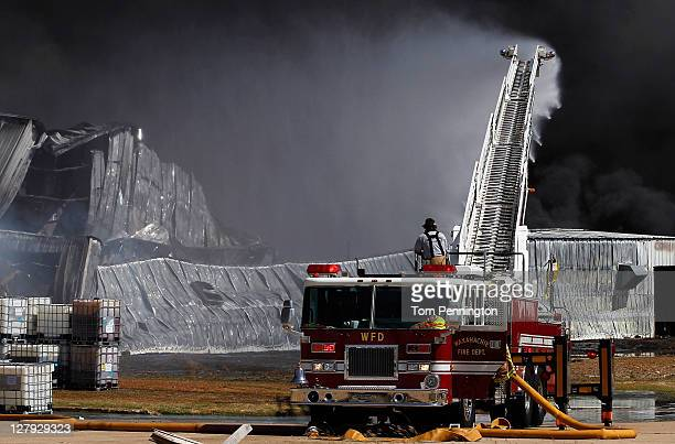 Waxahachie firefighters battle a massive fire at the Magnablend chemical processing plant on October 3 2011 in Waxahachie Texas The burning chemical...