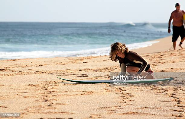 waxing a surfboard - waimea bay stock photos and pictures