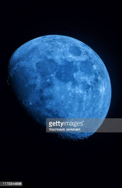 waxing gibbous ( blue ) moon beautiful in space. - blue balls pics stock pictures, royalty-free photos & images