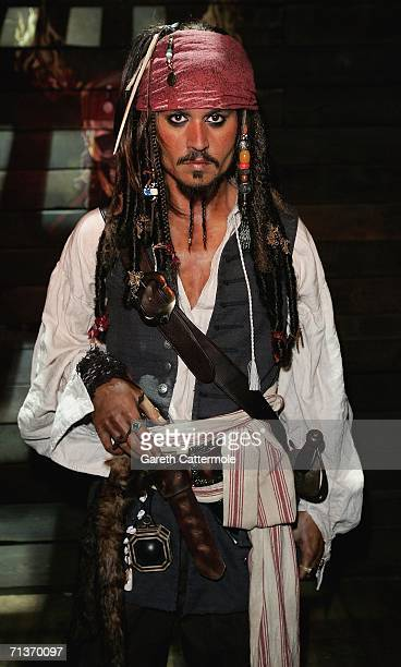 A waxwork model of Johnny Depp as Captain Jack Sparrow from Pirates of The Caribbean Dead Man's Chest forms part of an interactive attraction at...