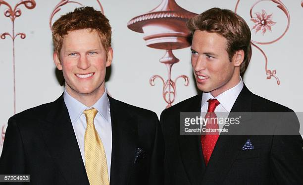 Waxwork models of Prince Harry and Prince William are seen together as Harrys model is unveiled as the latest installation at London tourist...