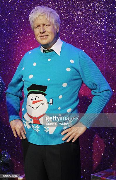 A waxwork of Boris Johnson is dressed in a Christmas jumper in support of the Save The Children campaign at Madame Tussauds on December 3 2013 in...