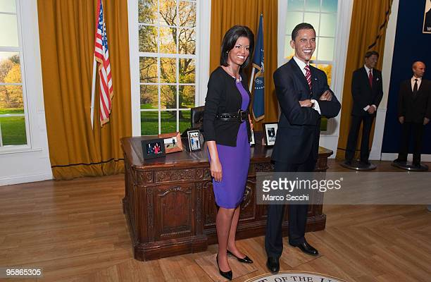 A waxwork of Michelle Obama is unveiled at Madame Tussauds next to a waxwork of her husband US President Barack Obama on January 19 2010 in London...