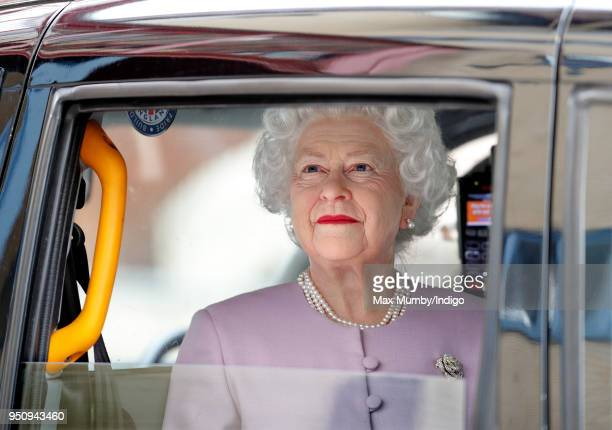 A waxwork of Queen Elizabeth II is driven in a London Taxi past the Lindo Wing of St Mary's Hospital following the news that Catherine Duchess of...