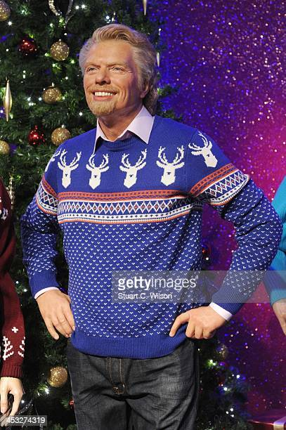 A waxwork of Richard Branson is dressed in a Christmas jumper in support of the Save The Children campaign at Madame Tussauds on December 3 2013 in...