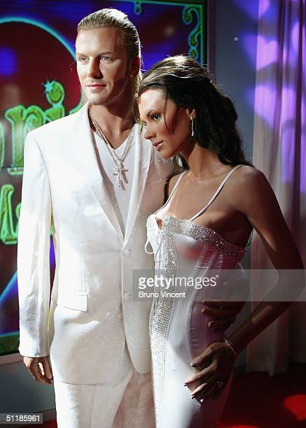 Waxworks of David and Victoria Beckham are seen at Madame Tussauds on August 18 2004 in London New models of Jennifer Aniston and Brad Pitt with...