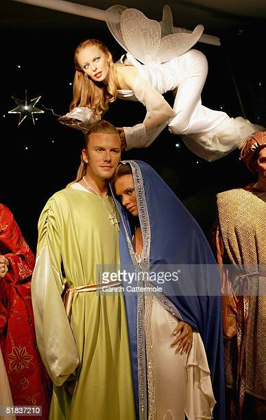 Waxworks of David and Victoria Beckham as Joseph and Mary and singer Kylie Minogue as an angel are on display in a new Nativity Scene at Madame...