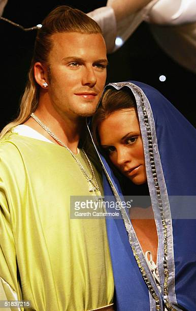 Waxworks of David and Victoria Beckham as Joseph and Mary are on display in a new Nativity Scene at Madame Tussauds for the Christmas period on...