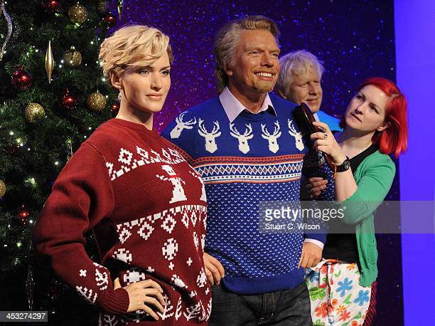 Waxworks of Kate Winslet Richard Branson and Boris Johnson are dressed in Christmas jumpers in support of the Save The Children campaign at Madame...