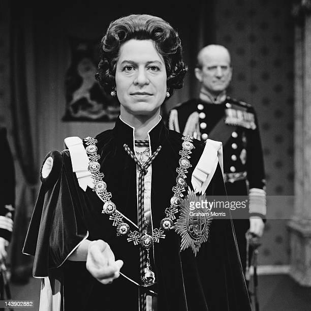 A waxworks of Queen Elizabeth II wearing ceremonial robes and the Order of the Garter at Madame Tussauds London 11th May 1977 The Prince Philip...