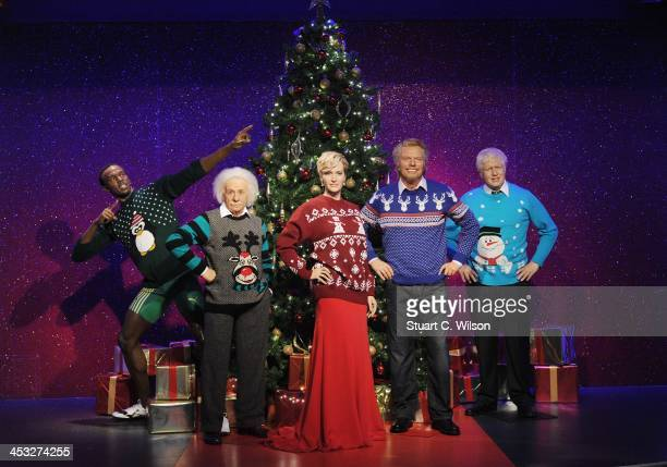 Waxworks of Usain Bolt Albert Einstein Kate Winslet Richard Branson and Boris Johnson are dressed in Christmas jumpers in support of the Save The...