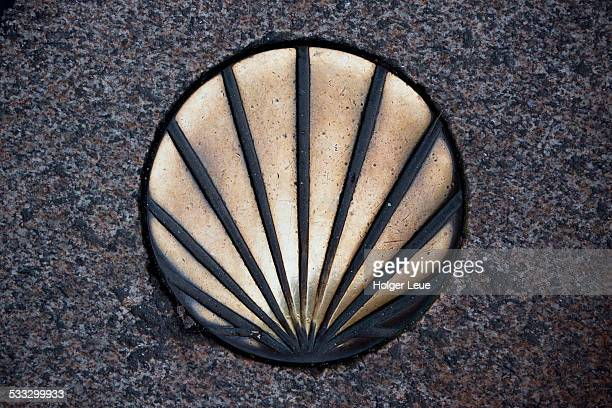 Way of St. James scallop shell symbol in pavement