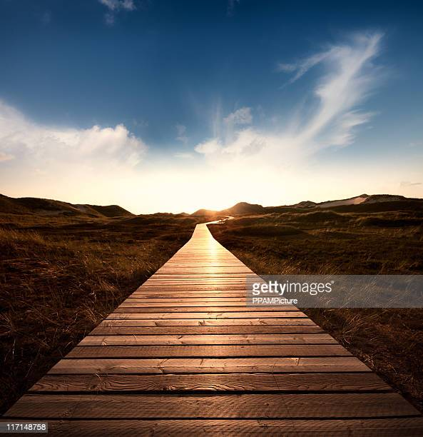way through the dunes with a huge sky - horizon stock pictures, royalty-free photos & images