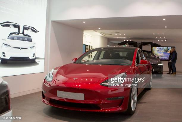 A way to a cleaner future Electro cars of the UScompany Tesla Inc Tesla Showroom in Cologne In the foreground the Tesla Model 3