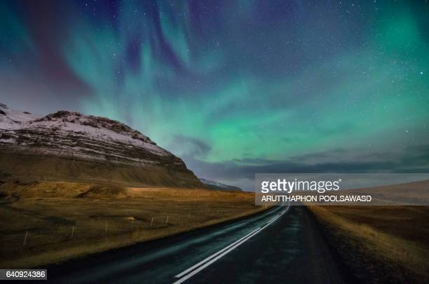 way to aurora borealis at scandinavia , mt. kirkjufell, iceland - north star stock pictures, royalty-free photos & images