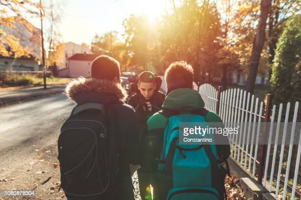 way to school. two angry teenage boys - bullying stock pictures, royalty-free photos & images