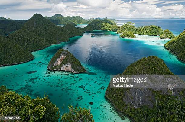 wayag - raja ampat islands stock photos and pictures