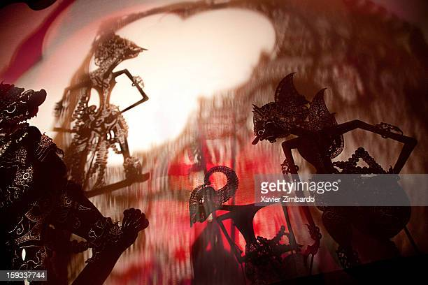 Wayang Kulit shadow puppets are seen during a theatre performance by the Great Master Dalang Ki Enthus Susmono on August 14 2009 at Jakarta in...