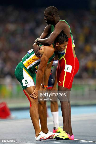 Wayde van Niekerk of South Africa celebrates with Kirani James of Grenada second place after winning the Men's 400 meter final on Day 9 of the Rio...