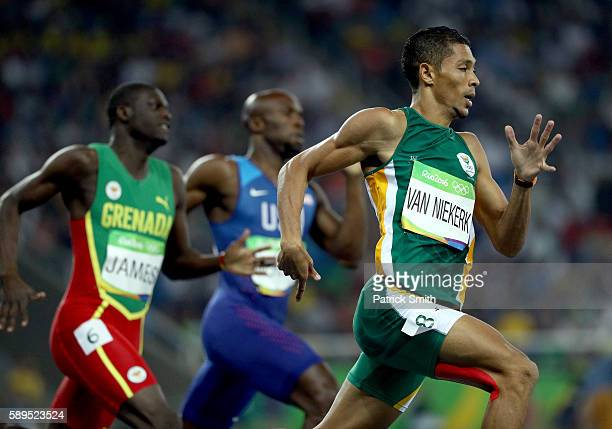 Wayde van Niekerk of South Africa competes the Men's 400 meter final on Day 9 of the Rio 2016 Olympic Games at the Olympic Stadium on August 14 2016...