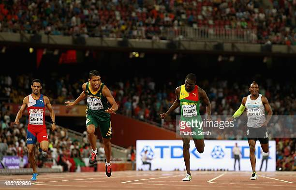 Wayde Van Niekerk of South Africa crosses the finish line to win gold ahead of Kirani James of Grenada in the Men's 400 metres final during day five...