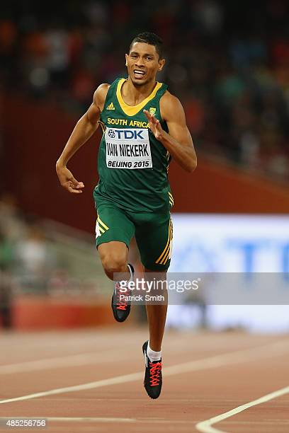 Wayde Van Niekerk of South Africa crosses the finish line to win gold in the Men's 400 metres final during day five of the 15th IAAF World Athletics...