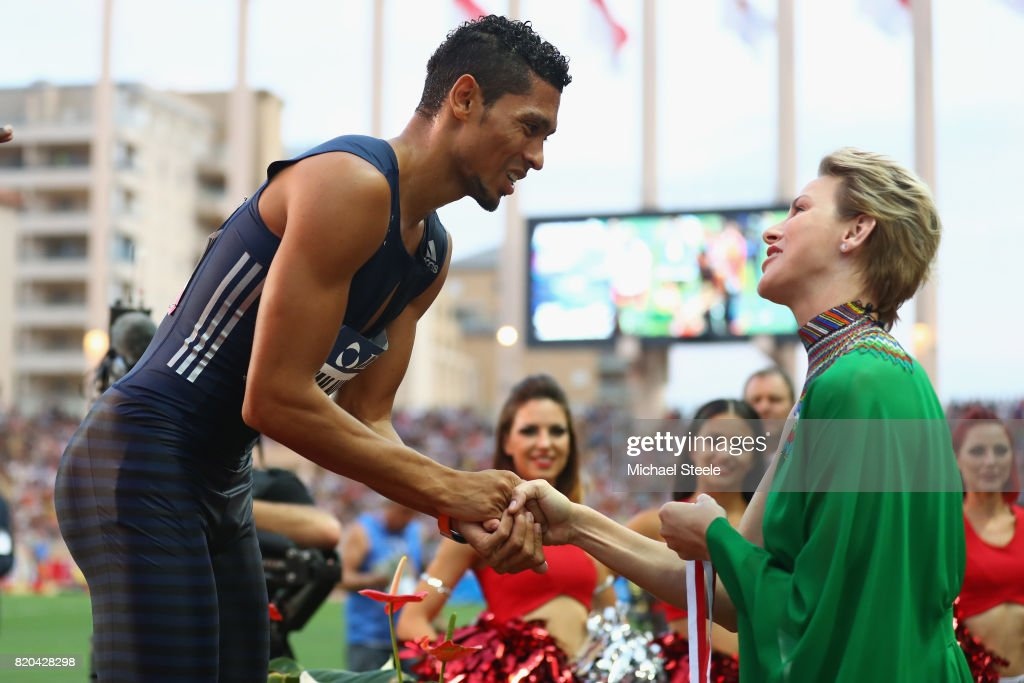 Wayde van Niekerk (L) of South Africa is presented a medal by Prince Charlene of Monaco during the IAAF Diamond League Meeting Herculis on July 21, 2017 in Monaco, Monaco.