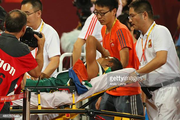 Wayde Van Niekerk of South Africa is stretchered off after winning gold in the Men's 400 metres final during day five of the 15th IAAF World...