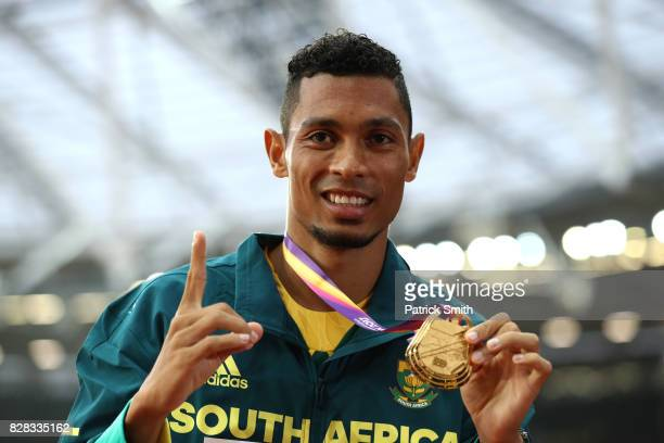 Wayde van Niekerk of South Africa poses with the gold medal for the Men's 400 metres during day six of the 16th IAAF World Athletics Championships...