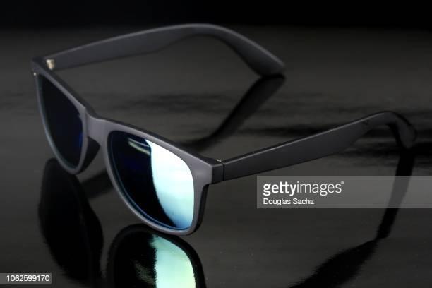 6aef4de14b5e1 Wayfarer styles sunglasses on a black background