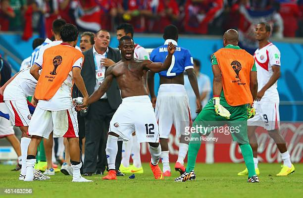 Waylon Francis and Patrick Pemberton of Costa Rica celebrate with teammates after defeating Greece in a penalty shootout during the 2014 FIFA World...