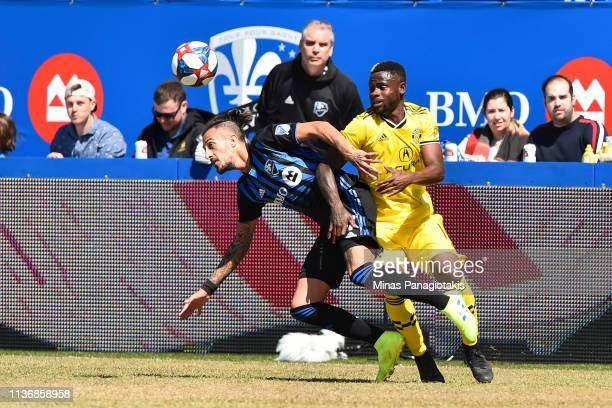 Waylon Francis of Columbus Crew challenges Maximiliano Urruti of Montreal Impact in the first half during the MLS game at Saputo Stadium on April 13...