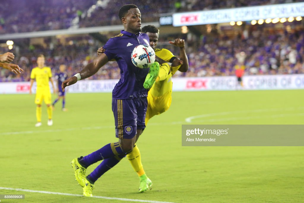 Waylon Francis #14 of Columbus Crew SC defends against Cyle Larin #9 of Orlando City SC during a MLS soccer match between the Columbus Crew SC and the Orlando City SC at Orlando City Stadium on August 19, 2017 in Orlando, Florida.