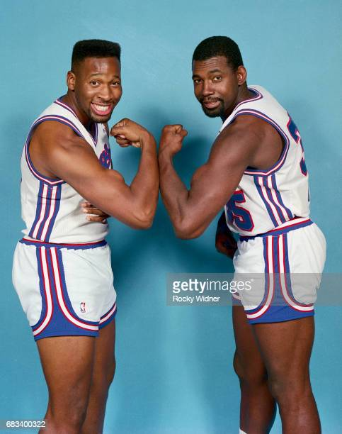 Wayman Tisdale and Antoine Carr of the Sacramento Kings flex for the camera circa 1990 at Arco Arena in Sacramento California NOTE TO USER User...
