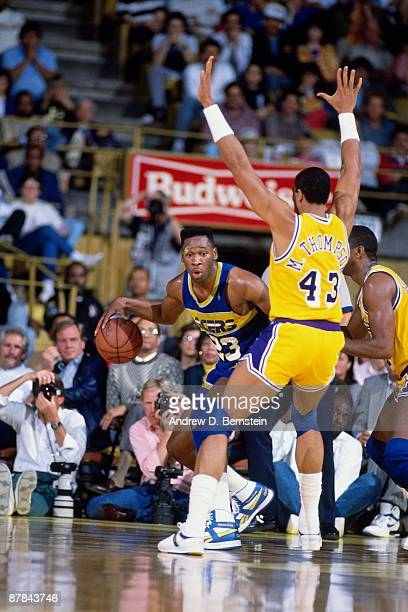 Wayman Tisdale of the Indiana Pacers moves the ball against Mychal Thompson of the Los Angeles Lakers during a game played in 1988 at the Great...