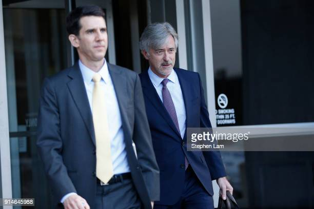 Waymo CEO John Krafcik right exits Phillip Burton Federal Building after day one of the trial between Waymo and Uber Technologies on February 5 2018...