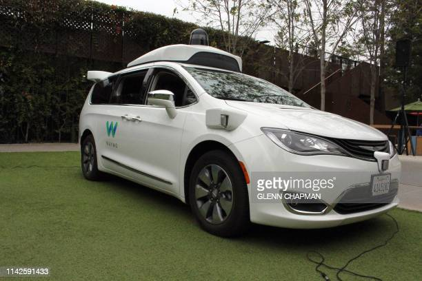 Waymo self-driving car pulls into a parking lot at the Google-owned company's headquarters in Mountain View, California, on May 8, 2019.
