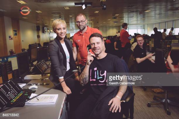 Wayne and Frankie Bridge and a BGC broker representing The Lily Foundation make a trade at BGC Charity Day on September 11 2017 in Canary Wharf...