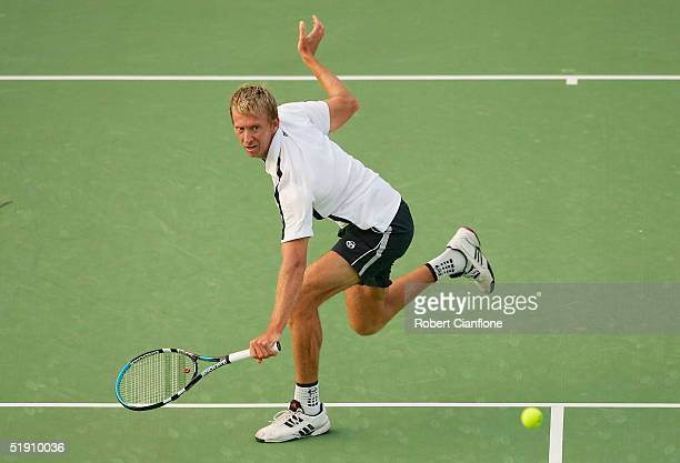 Wayne Arthurs of Australia returns a shot to Florin Mayer of Germany during day one of the Next Generation Hardcourts mens singles match at Memorial...