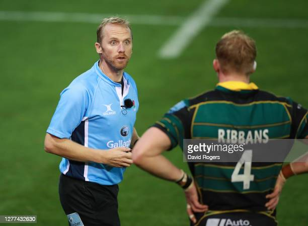Wayne Barnes the referee talks to David Ribbans of Northampton Saints during the Gallagher Premiership Rugby match between Northampton Saints and...