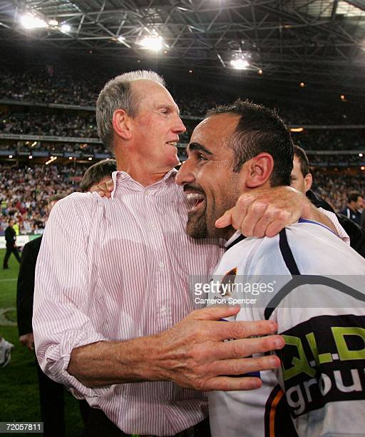 Wayne Bennett coach of the Broncos congratulates Tonie Carroll after winning the NRL Grand Final match between the Brisbane Broncos and the Melbourne...