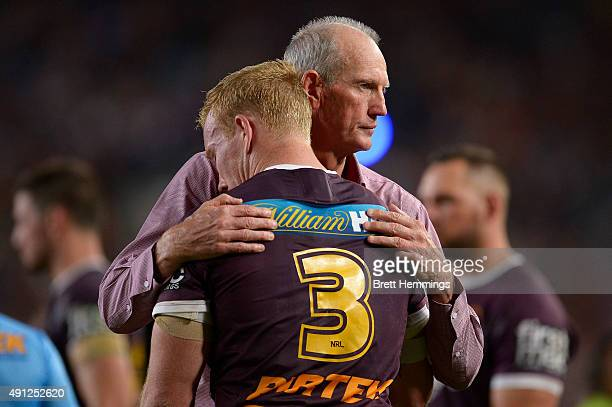 Wayne Bennett Coach of the Broncos hugs Jack Reed after defeat during the 2015 NRL Grand Final match between the Brisbane Broncos and the North...